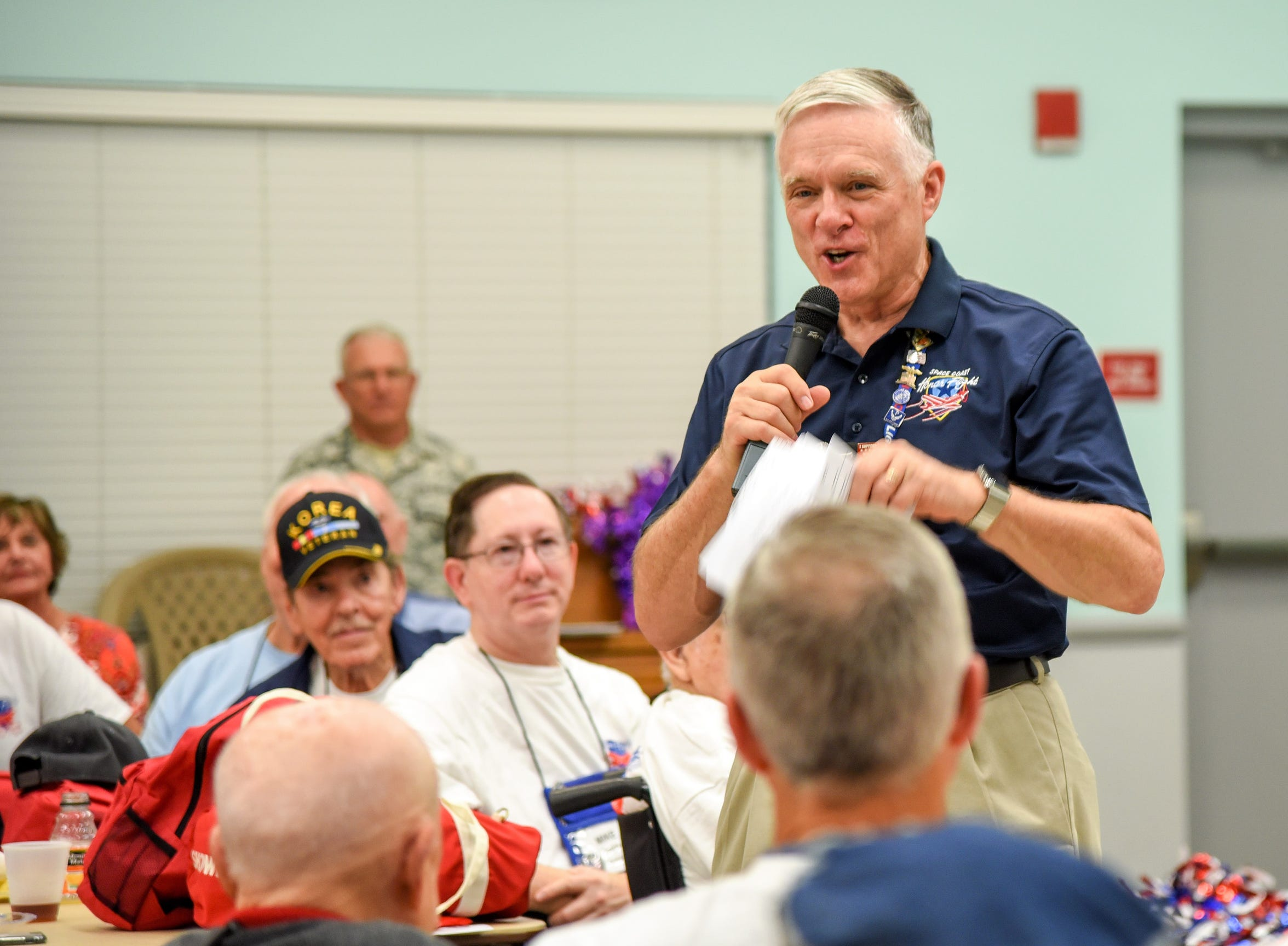 Space Coast Honor Flight President Bill Welser addresses the veterans about 2 a.m. at the Wickham Park Senior Center.