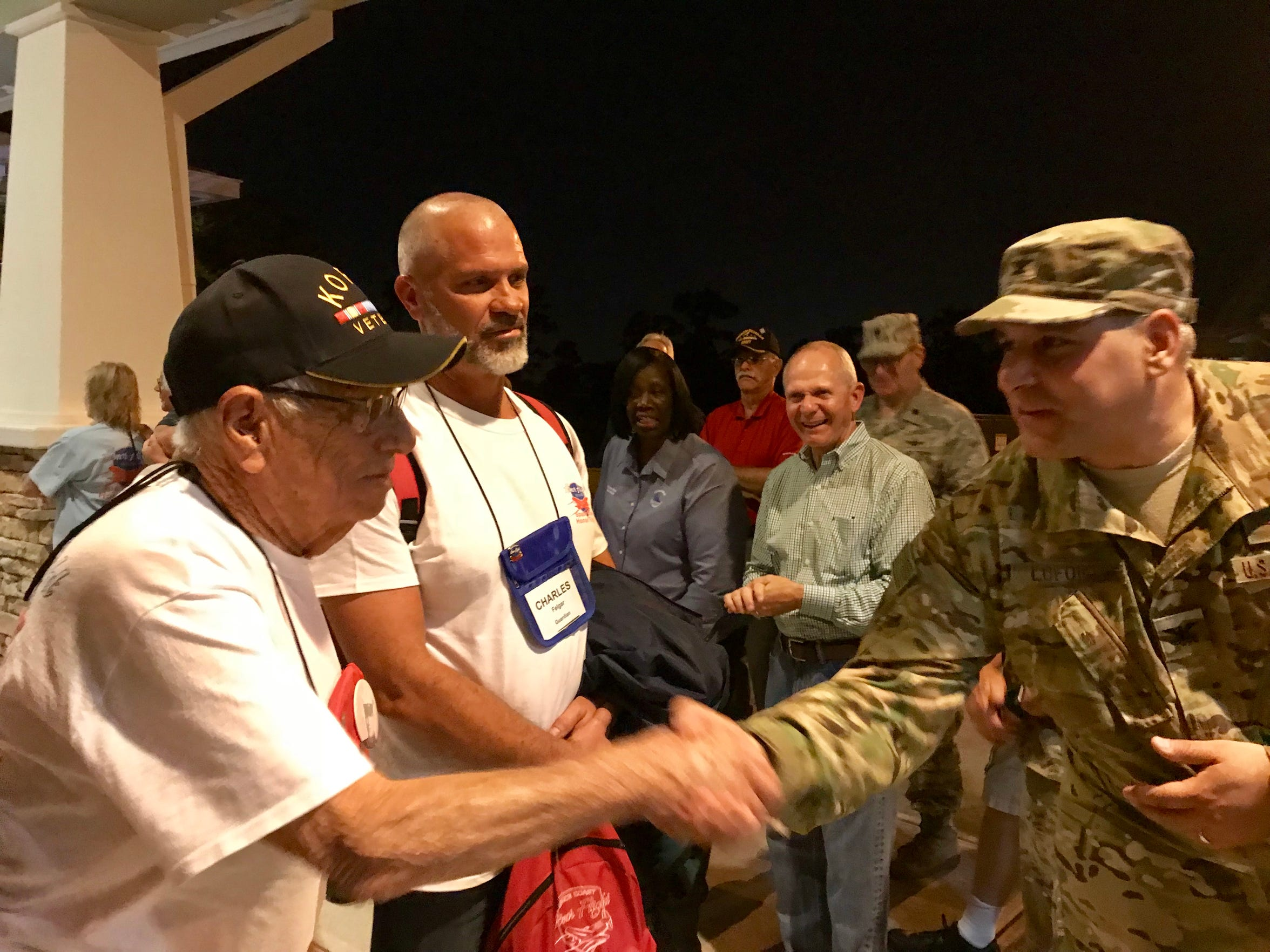 Korean War veteran Charles Felgar shakes hands with Air Force Col. Mike LoForti, commander of the 920th Operations Group at Patrick Air Force Base, outside the Wickham Park Senior Center.
