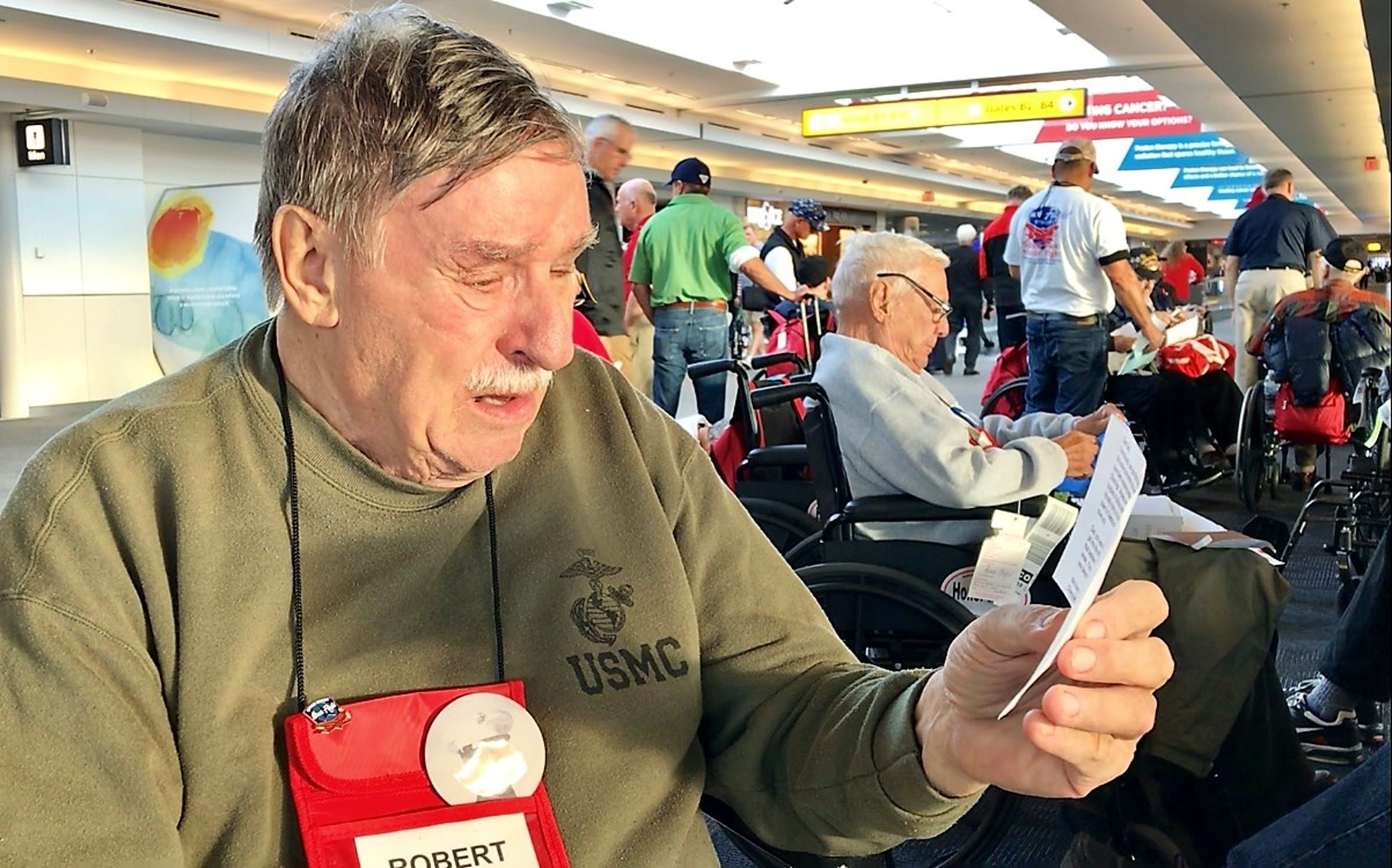 """Robert """"Bob"""" Marx, 83, of Indialantic cries while reading a letter from his daughter during a Space Coast Honor Flight at the Baltimore airport."""