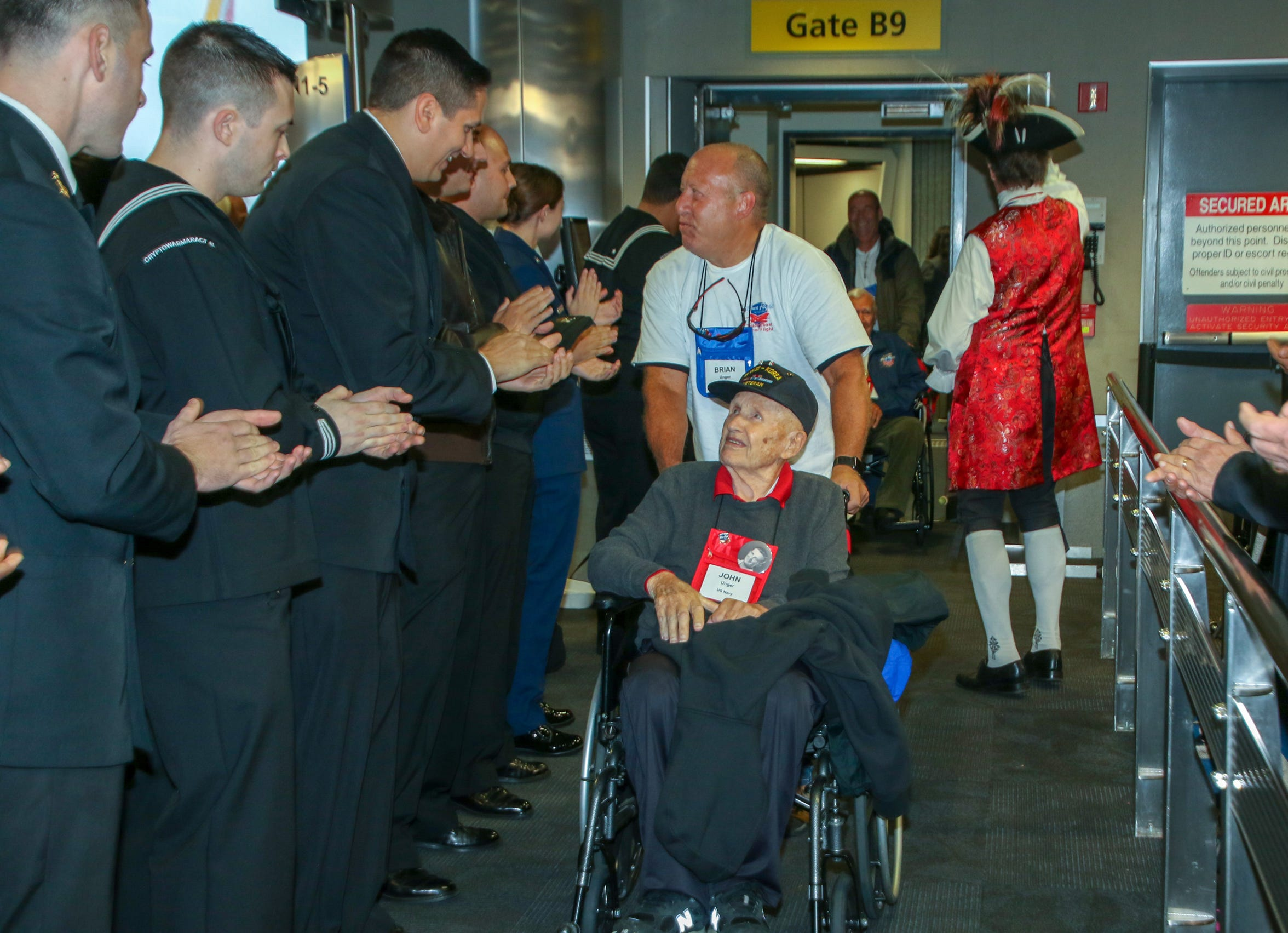 World War II prisoner of war John Unger, 98, is greeted by well-wishers at Baltimore/Washington International Airport during the Oct. 27 Space Coast Honor Flight.