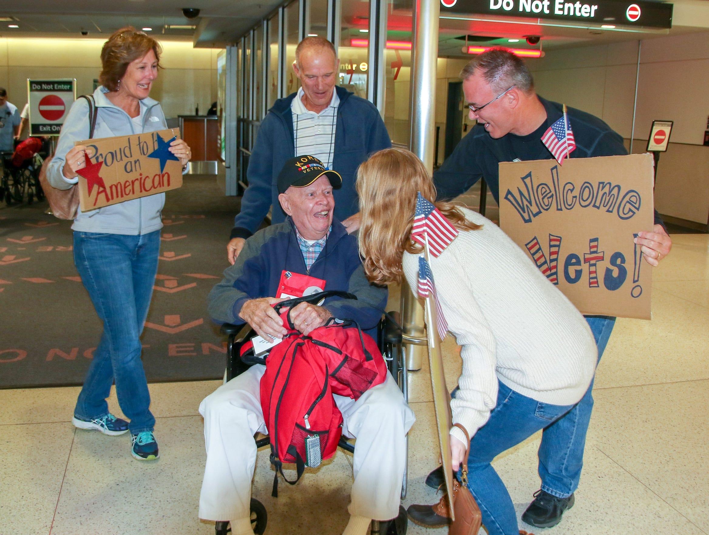 Well-wishers surprise Korean War veteran Ray Godfrey at Baltimore-Washington International Airport during the Oct. 27 Space Coast Honor Flight