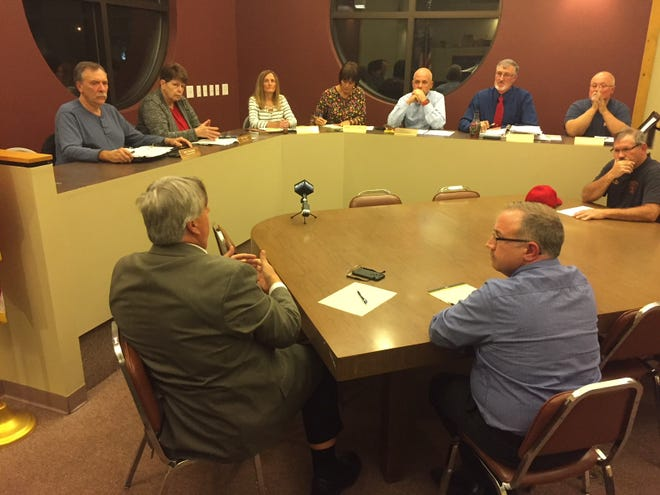 Members of Crestline Village Council listen to Crestline Village Solicitor Rob Ratliff during a special meeting Wednesday night.