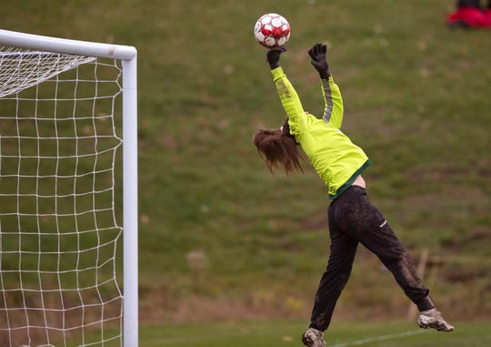 South Burlington goalie Hannah Murray makes a leaping save on a Champlain Valley free kick during Wednesday's Division I girls soccer semifinal in Hinesburg.