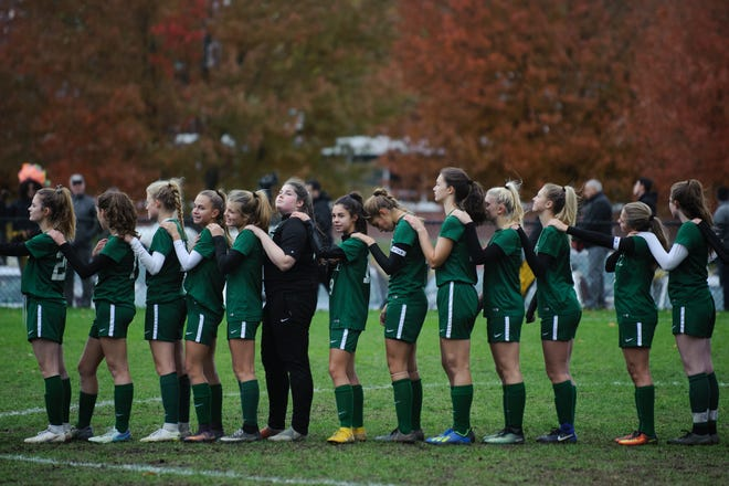 Rice listens to the National Anthem during the girls soccer semifinal game between Mount Abraham Eagles and the Rice Green knights at Rice Memorial High School on Wednesday afternoon October 31, 2018 in South Burlington.