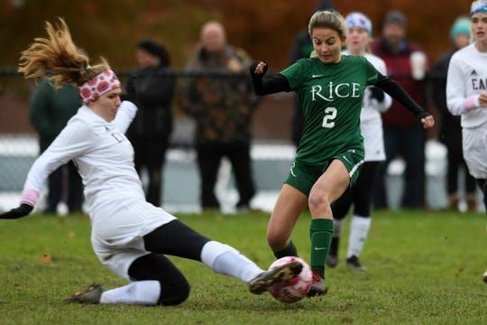 Mt. Abe's Emma Campbell (20) slides to play the ball as Rice's Hannah Shepard (2) runs down the field during the girls soccer semifinal game between Mount Abraham Eagles and the Rice Green knights at Rice Memorial High School on Wednesday afternoon October 31, 2018 in South Burlington.