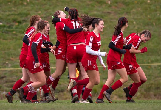 Champlain Valley players react after Josie Pecor's opening goal during Wednesday's Division I girls soccer semifinal in Hinesburg.