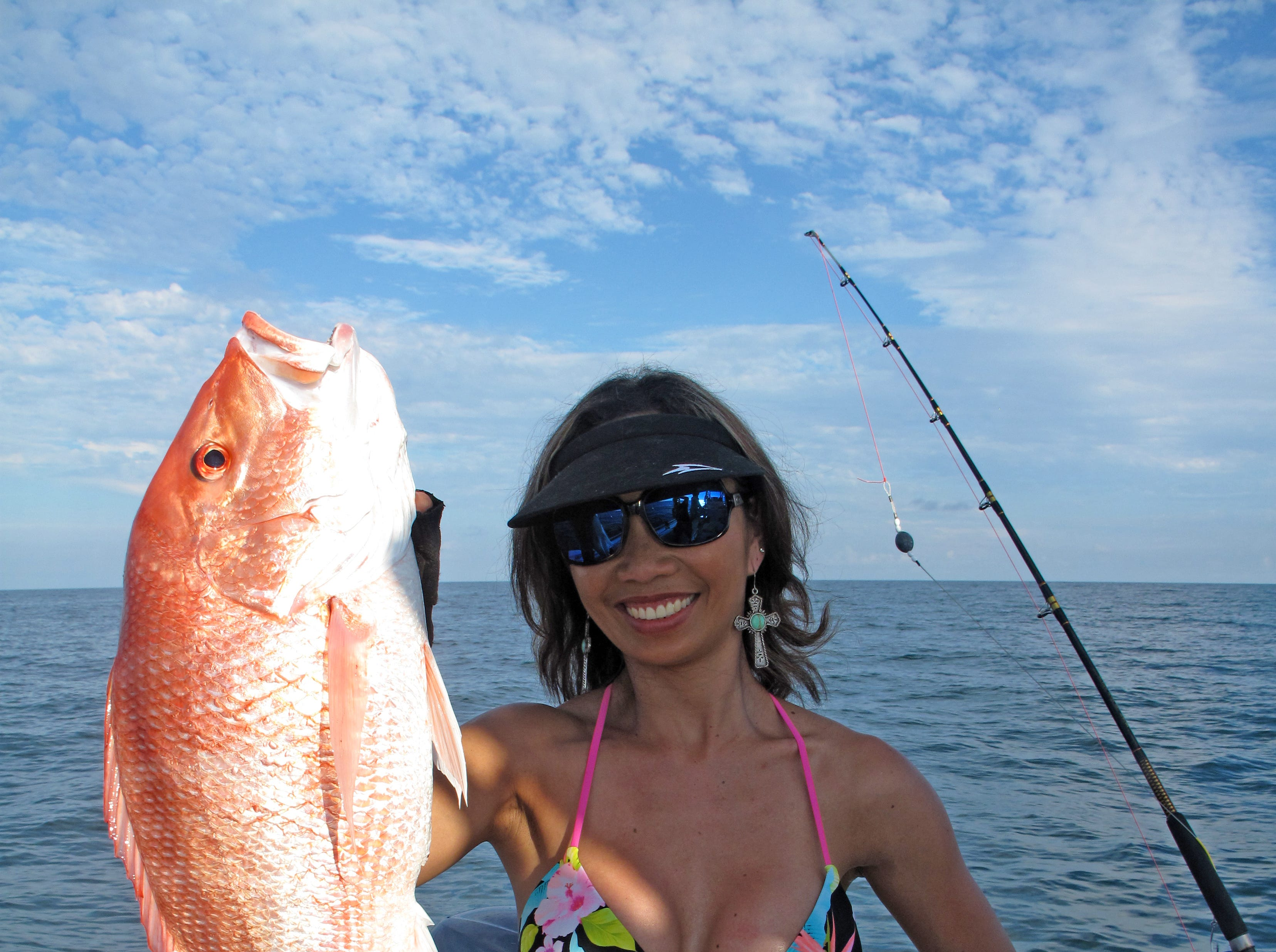 Crissy Layton caught this big red snapper while fishing offshore aboard the Fish & Fun II.