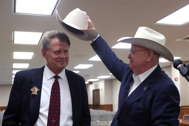 Nueces County Sheriff Chris Hooper (left) receives his first Stetson from outgoing Sheriff Jim Kaelin during the ceremony in which Hooper officially became sheriff at the Nueces County Courthouse on Thursday, November 1, 2018.