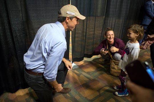 Democratic candidate Beto O'Rourke, who is running for U.S. Senate against Republican Ted Cruz, talks to Heather Shields (left) and her daughter Deia Perez, 3, before speaking with supporters at the Richard M. Borchard Regional Fairgrounds in Robstown on Thursday, November 1, 2018.