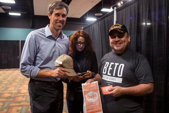 Senate challenger Beto O'Rourke (left), received a gift of Whataburger gift cards and a Whataburger hat from Mario Gomez (right) before speaking to supporters in Robstown in early November.