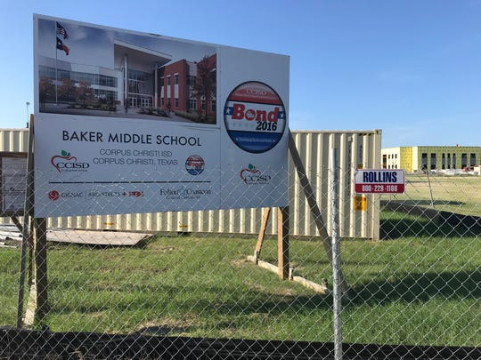 Graduates of Baker Middle School are being summoned to take a group photo outside the 64-year-old campus before it's torn down.