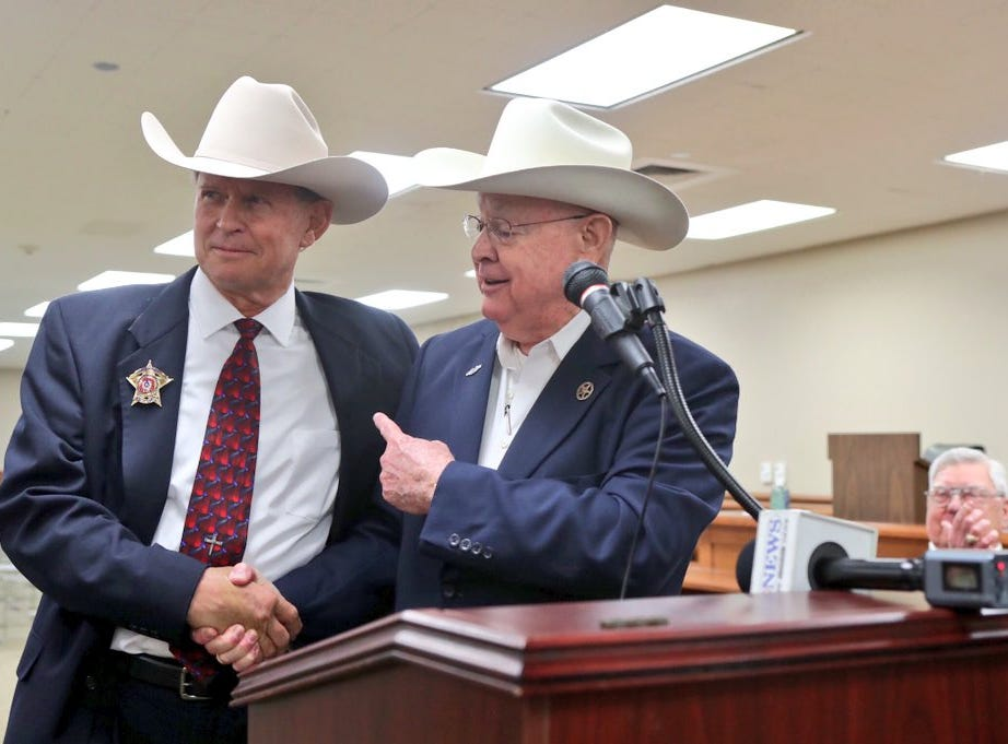 New Nueces County Sheriff J.C. Hooper (left) shakes hands on Thursday, Nov. 1, 2018, with Jim Kaelin, who retired after several years in the top law enforcement role.
