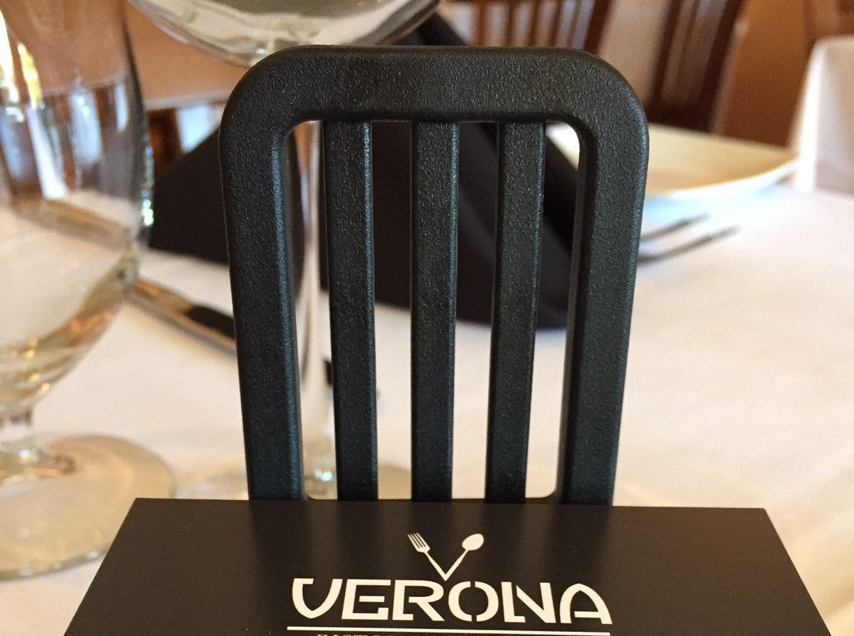 Business cards at the host station announce the arrival of Verona Ristorante Italiano in Haddonfield. The restaurant is in the site formerly occupied by Little Tuna.
