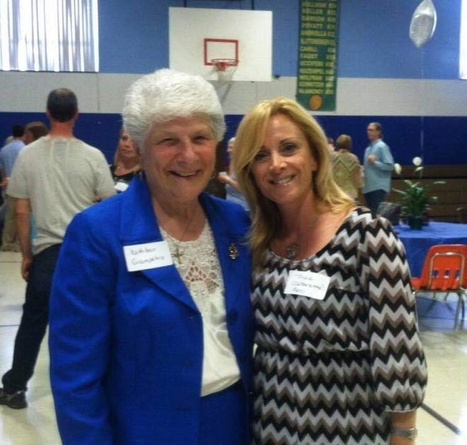 Kathleen Giampetro, who taught at Queen of Heaven School in Cherry Hill  for 12 years, attends a 2015 reunion with one of her former students, Tricia Calzaretto-Ferri. Another reunion is planned for Saturday.