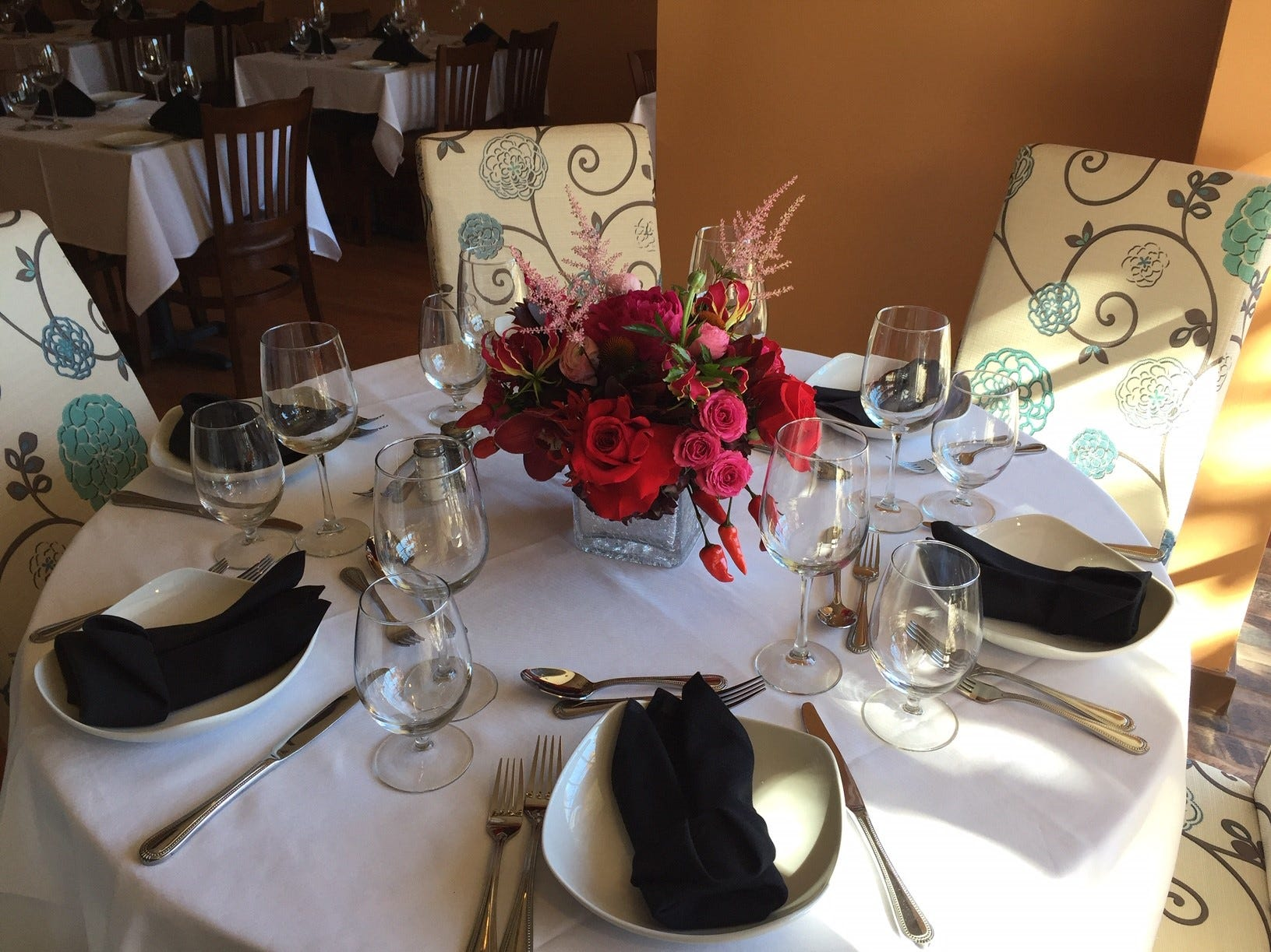 The chef's table at Verona Ristorante Italiano features a floral centerpiece by Michael Bruce Florist.