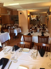 Verona Ristorante Italiano offers a contemporary dining room with white linen table clothes and wine glasses for either BYOB or New Jersey wines.