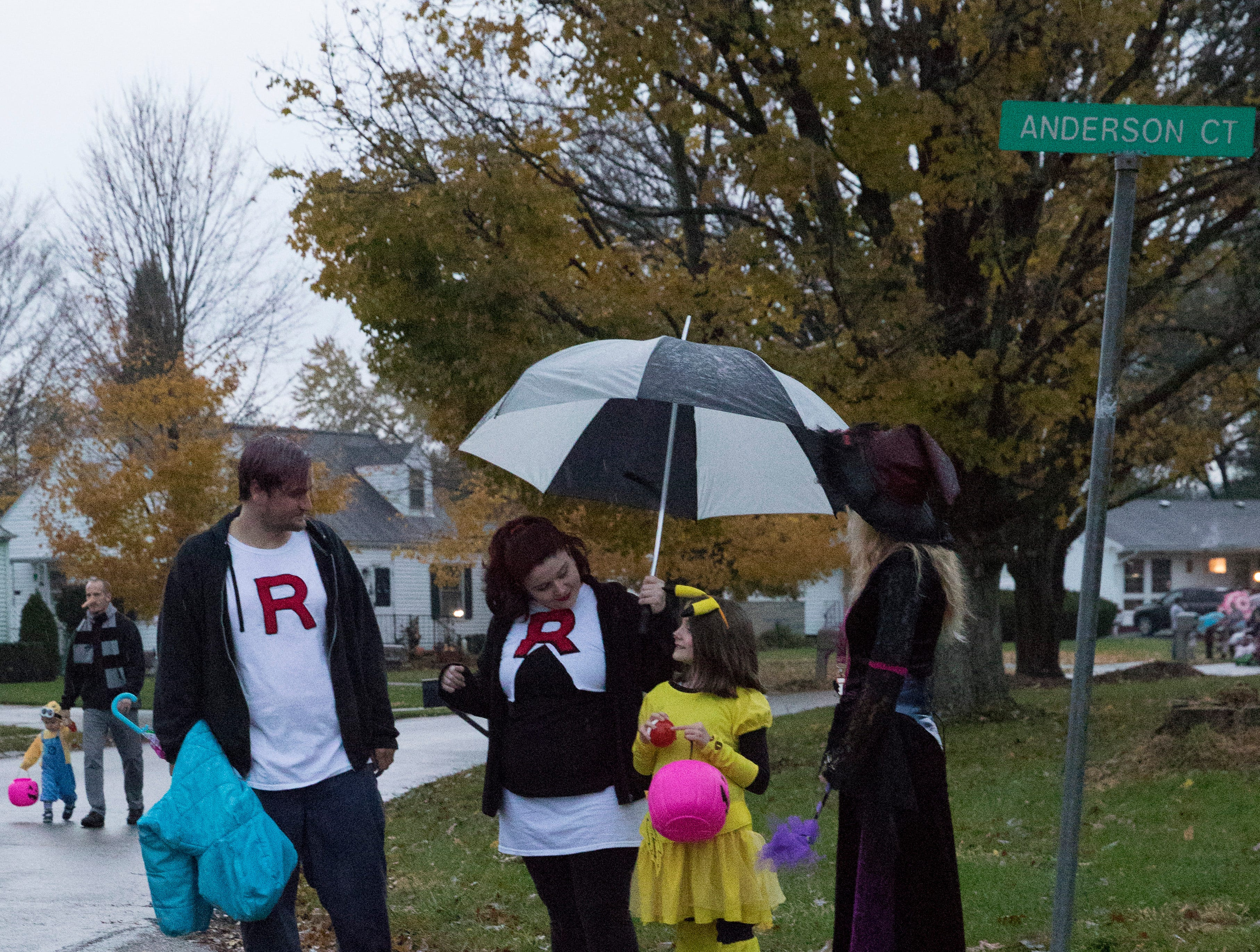 The rain and mud did not stop residents from collecting candy on trick-or-treat night in Chillicothe, Ohio, on October 31, 2018.
