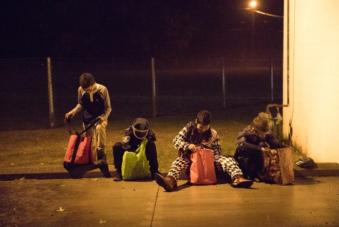 Local kids in Chillicothe, Ohio, look through their candy as trick-or treat came to an end in Chillicothe Wednesday evening.