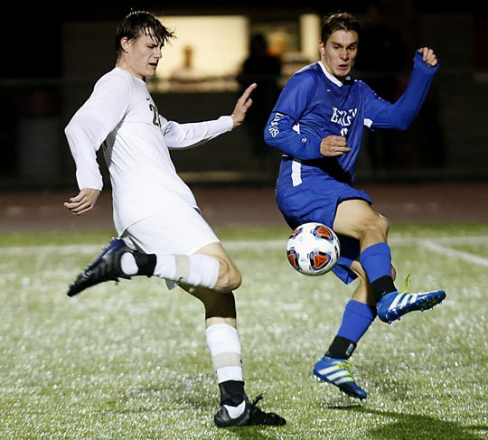 McNicholas forward Evan Brunot prepares to score against Bexley defender Grant Halliday during their Division II boys regional soccer tournament game at London Wednesday, Oct. 31, 2018.
