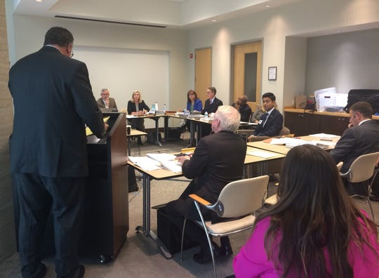 Democratic congressional candidate Aftab Pureval answers questions about a campaign spending complaint before the Ohio Elections Commission on Thursday.