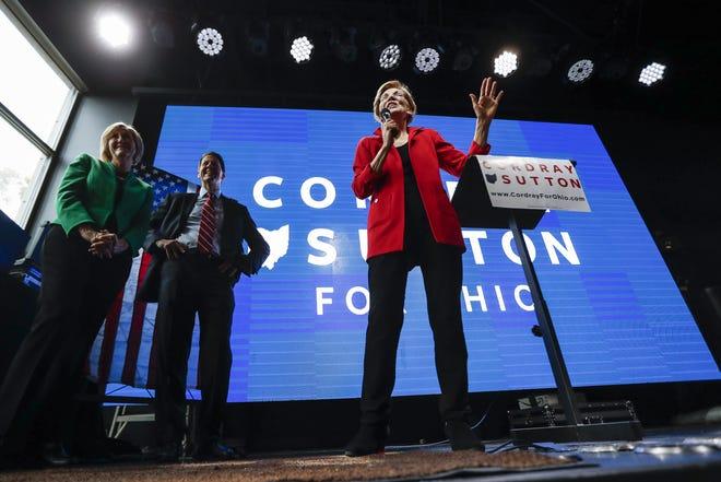 Democratic candidate for U.S. Senate from Massachusetts, incumbent Elizabeth Warren, center, speaks alongside Ohio Democratic gubernatorial candidate Richard Cordray during a campaign event, Thursday, Nov. 1, 2018, in Columbus, Ohio.