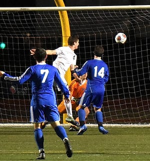 Turpin's Max Murphy (4) pops in the winning goal on a header as the Spartans top St. Xavier 2-1 at the Division I regional semifinal, October 31, 2018.