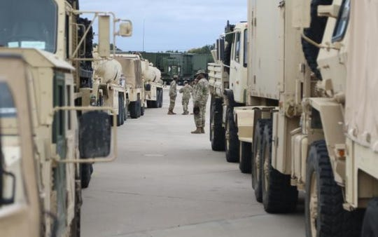 Troops prepare to move out in support of Operation Faithful Patriot.