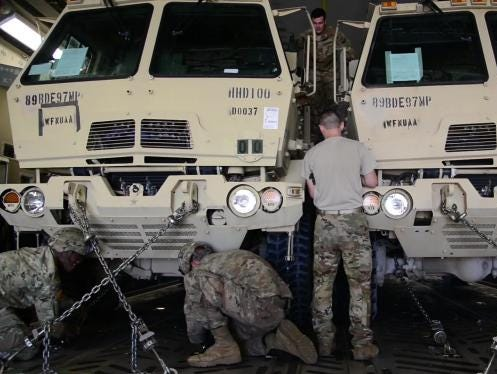 Troops load equipment in support of Operation Faithful Patriot.