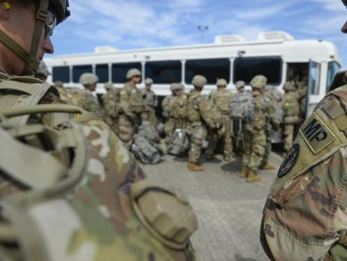 Active duty Army troops arriving in Texas as part of Operation Faithful Patriot.
