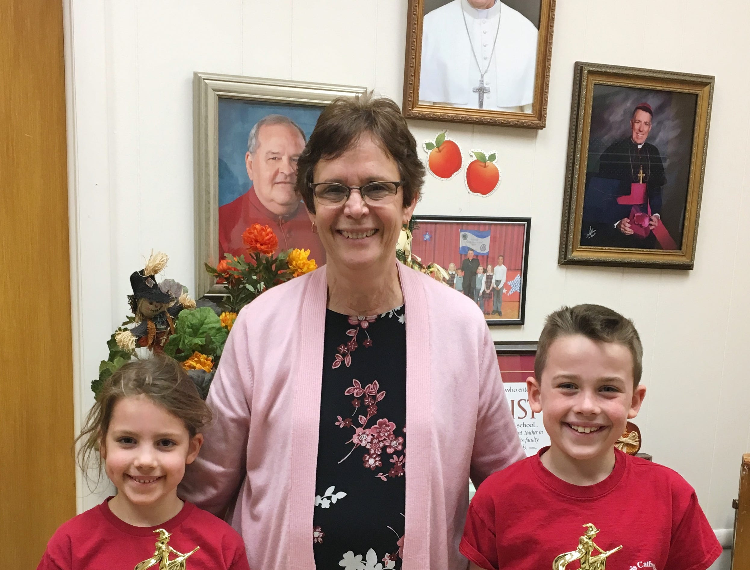 Congratulations to St. Francis Cathedral School (SFCS) brother and sister, Brendan and Norah Mullins who were the winners of the Metuchen Recreation Poster Painting Contest pictured here with Principal Ann Major.  Brendan is a third grader and Norah is in first grade. The event was held on October 16th and was open to Kindergarten through 4th Grade students. SFCS educates children from Pre K through 8th Grade in Metuchen.