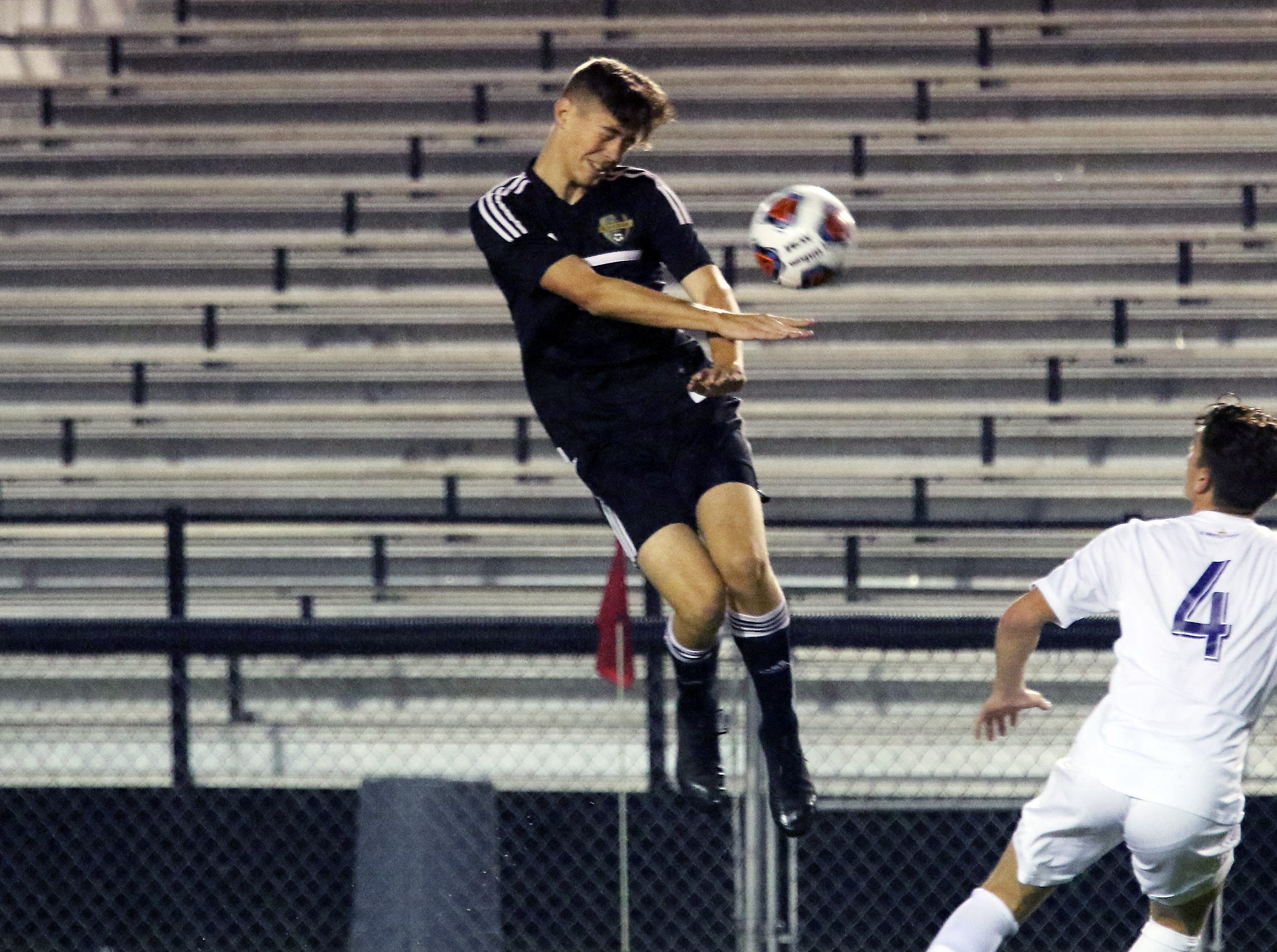 A River View player heads the ball against DeSales.