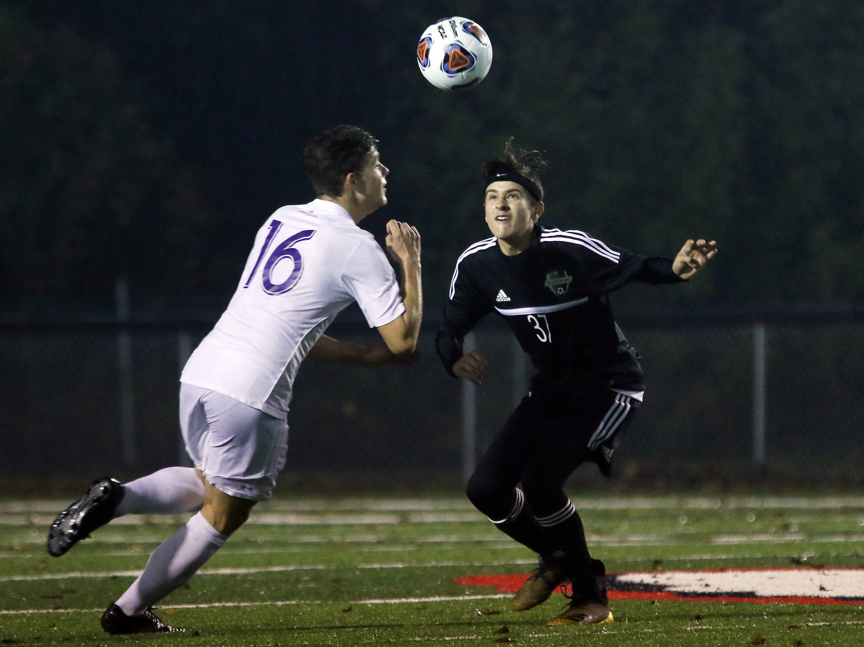 River View's Andrew Ireland and DeSales' Josh Conroy close in on the ball.