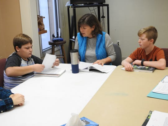 Carol Kinsey teaches English and writing at the Coshocton Christian Learning Co-Op with students Troy Morrow and Nicholas Phillips, both 11.