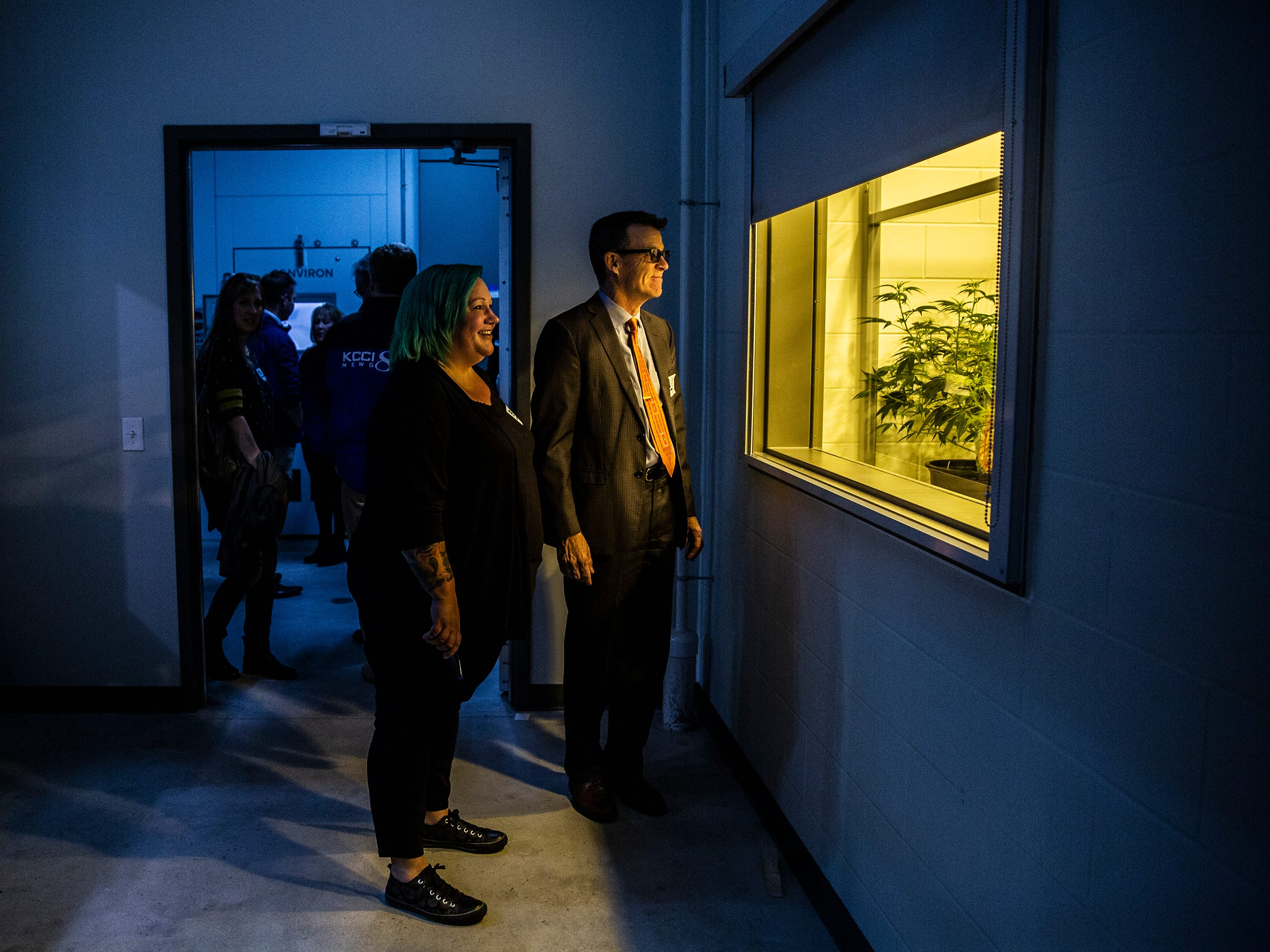 Erin Bollman, of Dallas Center, and an advocate for the use of medical-marijuana, views one of the growing rooms inside Iowa's first facility for the production of medical-marijuana, MedPharm Iowa, during a ribbon cutting event on Thursday, Nov. 1, 2018, in Des Moines.