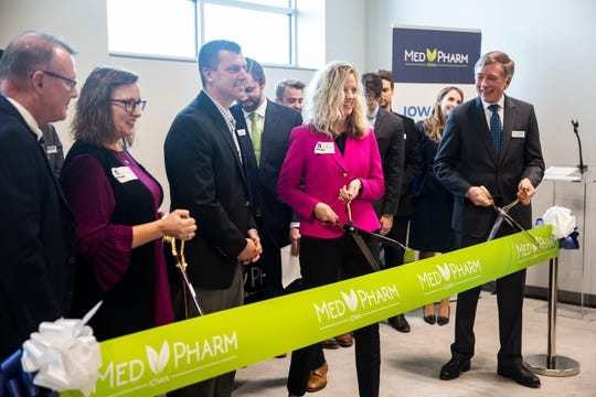 Advocates, lawmakers and people involved in the opening of Iowa's first medical-marijuana production facility, MedPharm, cut the ribbon during an open house on Thursday, Nov. 1, 2018, in Des Moines.