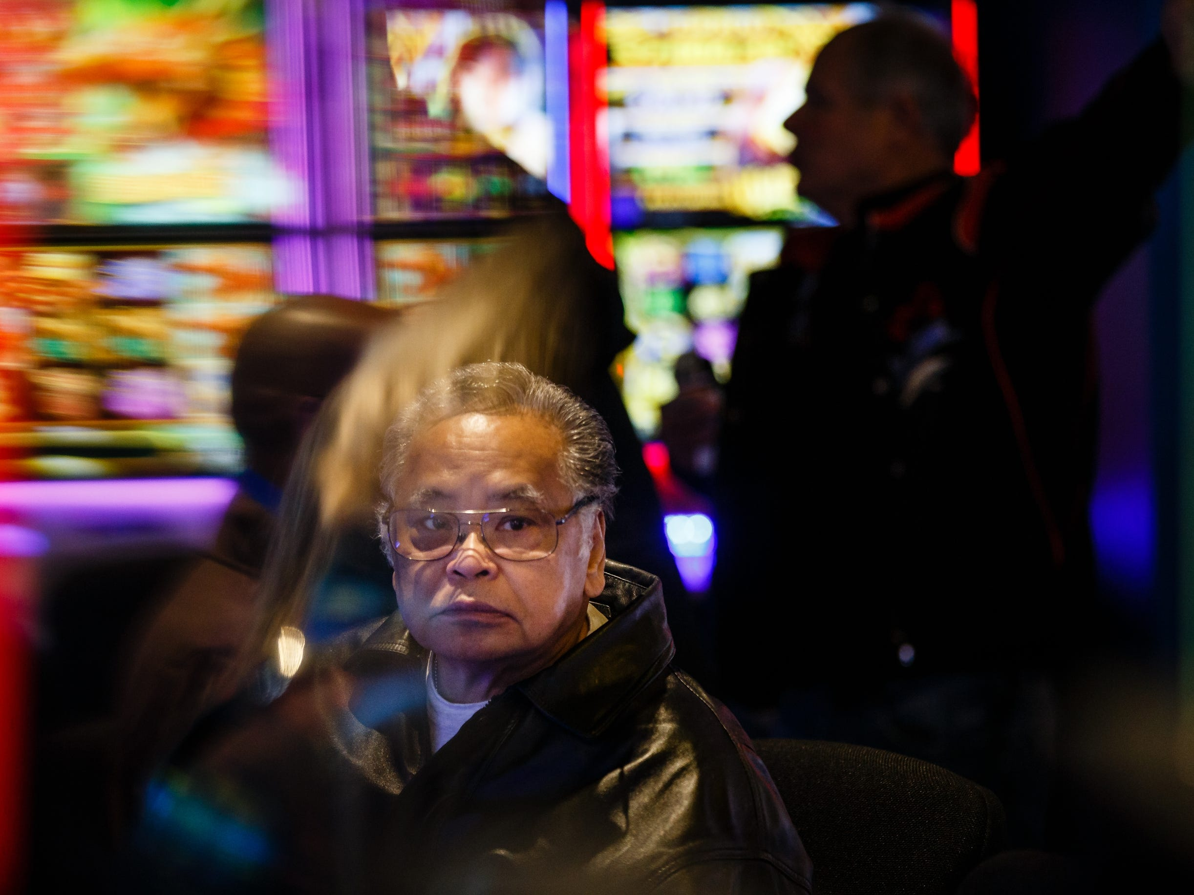 Luis Fortun of Omaha plays a slot machine during the grand opening of The Ponca Tribe of Nebraska's Prairie Flower Casino on Thursday, Nov. 1, 2018, in Carter Lake. Both Iowa and Nebraska officials have tried to block the casino in federal court Ð Iowa because of competition with other Iowa casinos and Nebraska because the casino sits just miles away from Omaha where gambling is illegal.