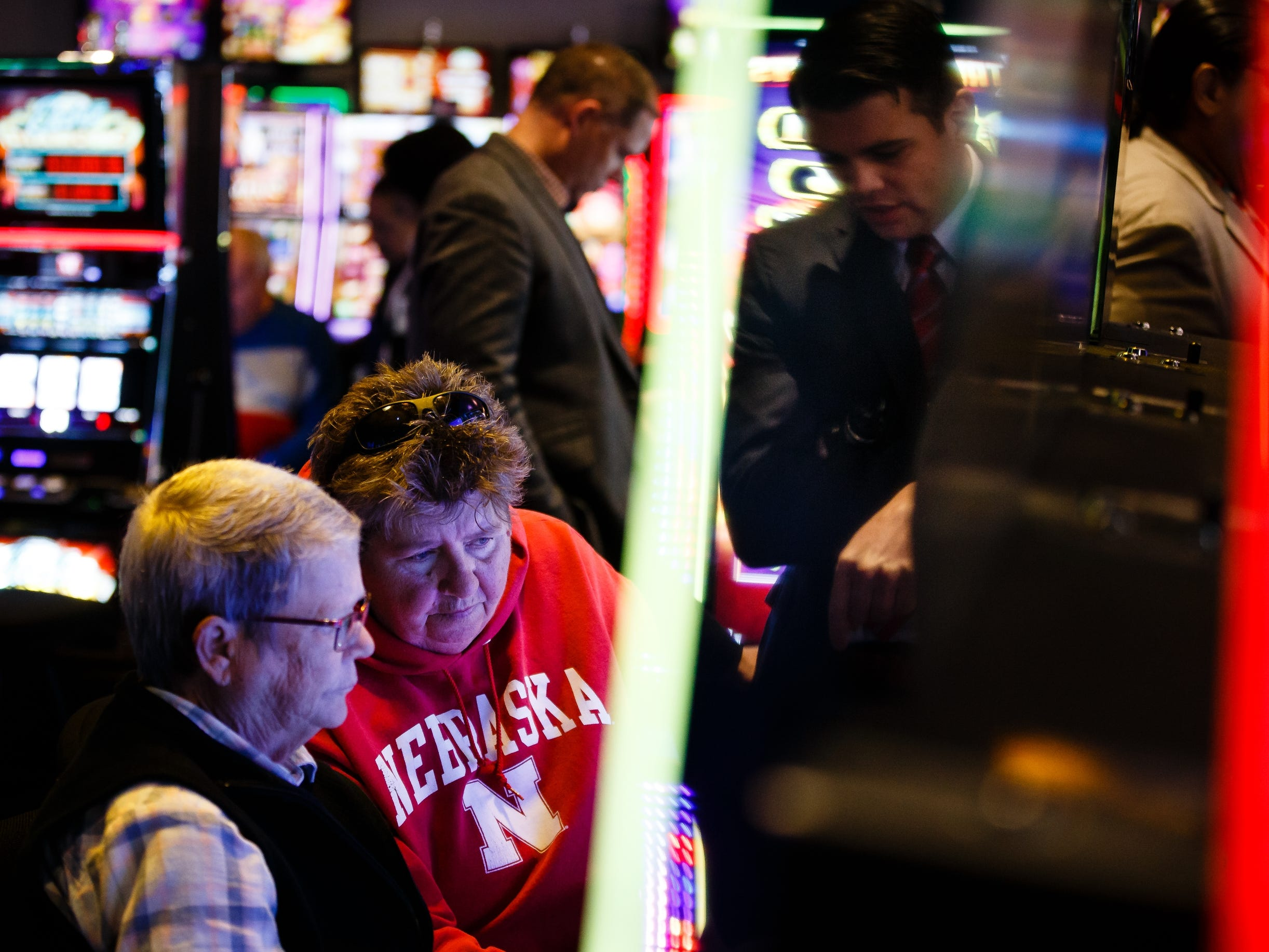 Pam Brown, top, and Linda Buckley, bottom, both of Omaha play a slot machine during the grand opening of The Ponca Tribe of Nebraska's Prairie Flower Casino on Thursday, Nov. 1, 2018, in Carter Lake. Both Iowa and Nebraska officials have tried to block the casino in federal court Ð Iowa because of competition with other Iowa casinos and Nebraska because the casino sits just miles away from Omaha where gambling is illegal.