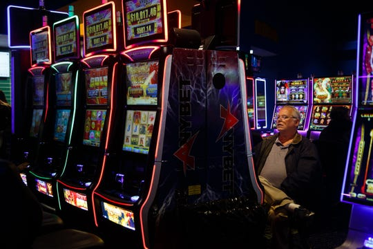 Jerry Virden of Bellevue, NE plays a slot machine during the grand opening of The Ponca Tribe of Nebraska's Prairie Flower Casino on Thursday, Nov. 1, 2018, in Carter Lake. Both Iowa and Nebraska officials have tried to block the casino in federal court Ð Iowa because of competition with other Iowa casinos and Nebraska because the casino sits just miles away from Omaha where gambling is illegal.