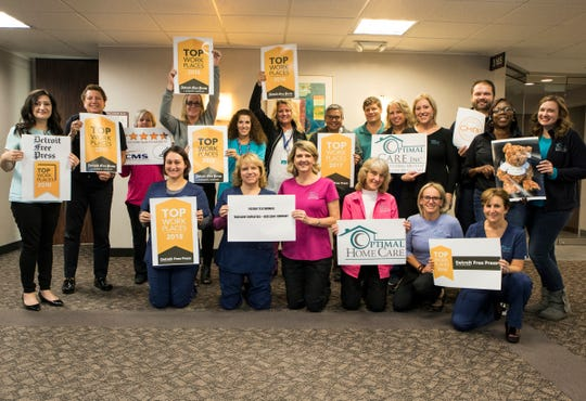 Staff gather for a group photo at Optimal Care Inc. in Bingham Farms, Mich., Wednesday, Oct 17, 2018.