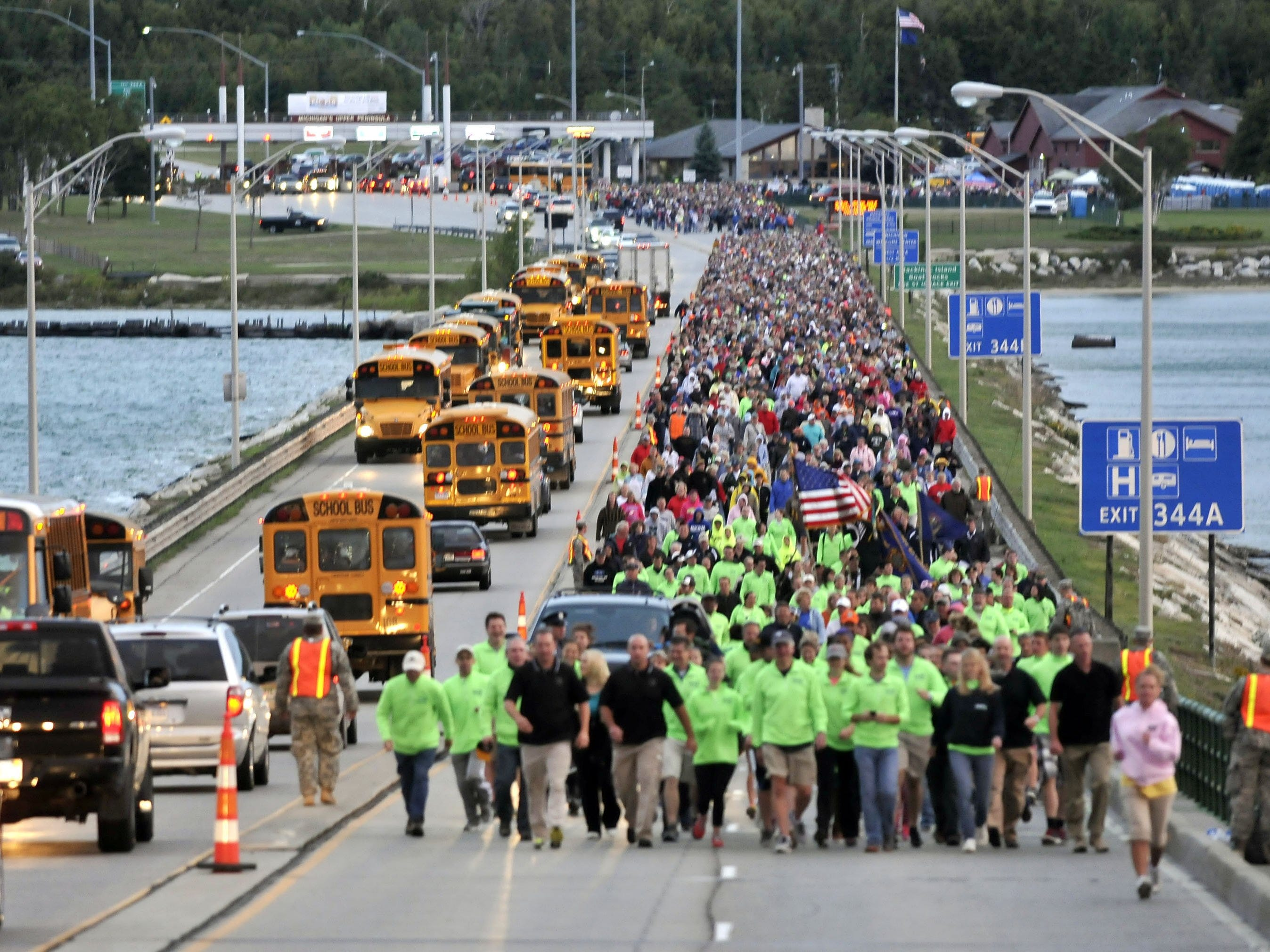 Michigan Gov. Rick Snyder walks with friends and visitors during the beginning of the Labor Day Bridge Walk across the five-mile-long Mackinac Bridge, Monday, Sept. 2, 2013 during the annual event. Labor Day is the only day pedestrians are allowed on the span, which connects Michigan's upper and lower peninsulas.