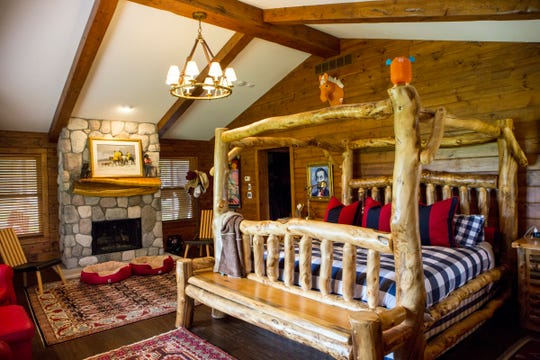 The massive log furniture was made by a local artisan. He also made the curved bedroom mantel from a hollowed walnut log.