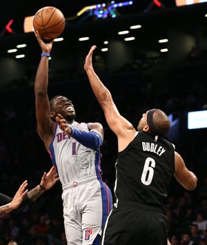 Detroit Pistons guard Reggie Jackson (1) puts up a shot against Brooklyn Nets forward Jared Dudley (6) in the second quarter at Barclays Center.