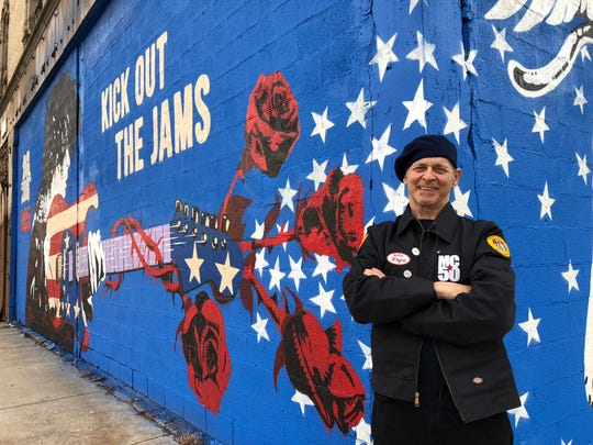 MC5 guitarist Wayne Kramer in front of the new MC5 mural at the Grande Ballroom in Detroit.