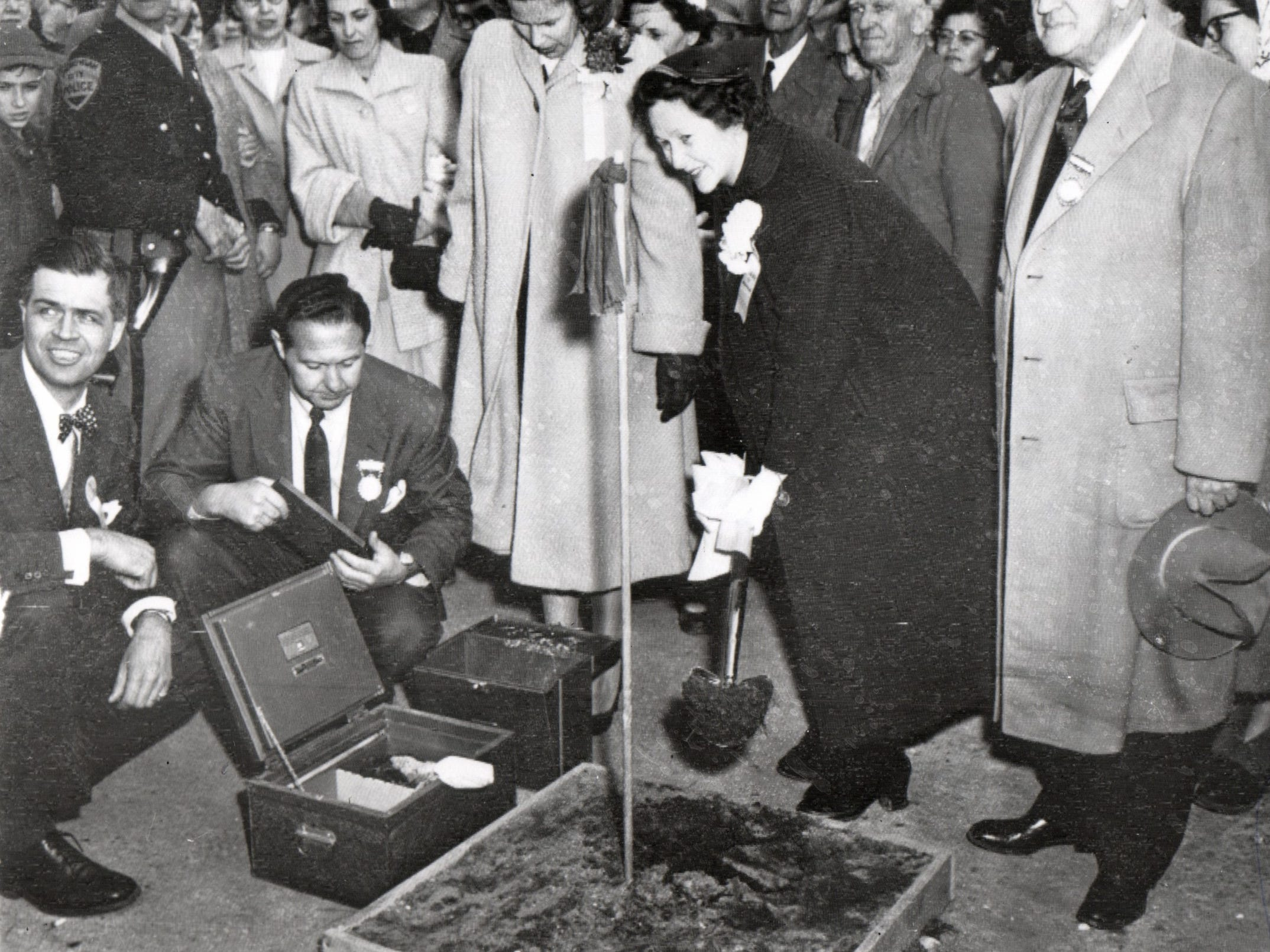 Mrs. Charles T. Fisher, Jr., wife of the bridge authority vice chairman, turns over the first spadeful of dirt during ground-breaking ceremonies here Sat. May 8, 1954. \ (L-R) Gov. G. Mennen Williams; Lawrence Rubin, bridge authority secretary; Nancy Williams, Mrs. Fisher, Detroit, and Prentiss M. Brown, Chairman, bridge authority.