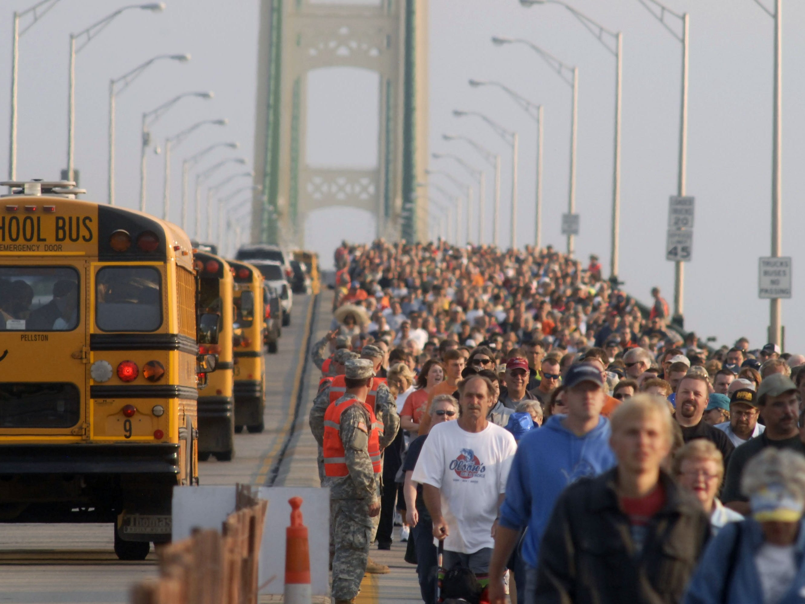 Thousands of people head south during the annual Labor Day Mackinac Bridge Walk, Monday, Sept. 3, 2012. Gov. Rick Snyder has led thousands of walkers and runners across the bridge for one of Michigan's most popular Labor Day traditions.