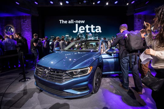 Guests check out a 2019 Volkswagen Jetta at the Garden Theater in Detroit on Sunday, Jan. 14, 2018.