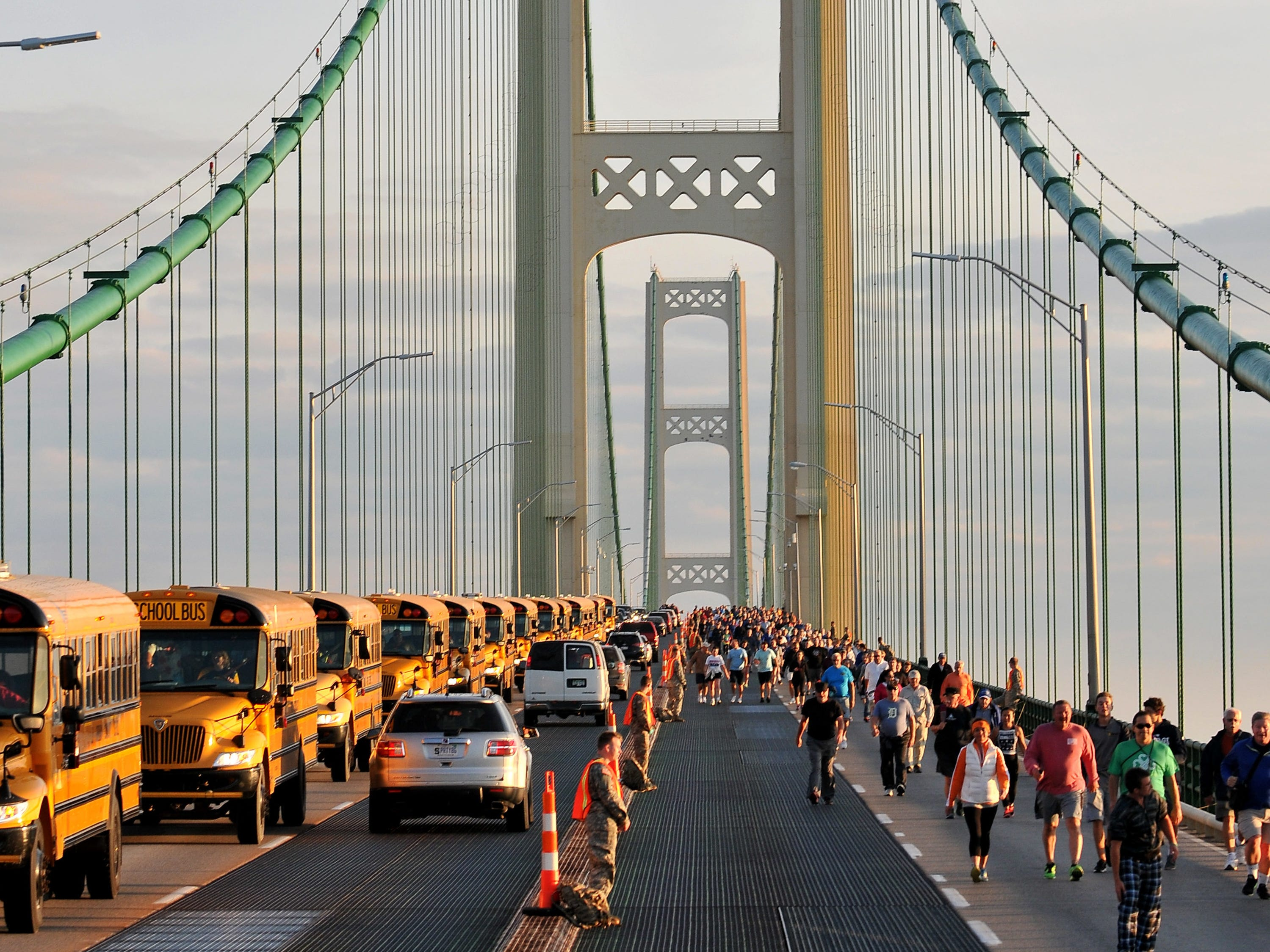 Walkers head south during the 59th annual Mackinac Bridge Walk on Monday, Sept. 5, 2016. Labor Day is the only time pedestrians are allowed on the five-mile-long span which connects the lower peninsula at Mackinaw City, Mich., to the Upper Peninsula at St. Ignace, Mich.