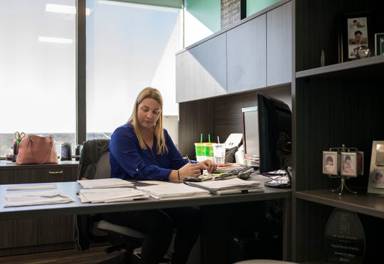 Office Manager Darci Barerra works in her office at Financial Services of America in Warren, Mich., Tuesday, Oct. 16, 2018.