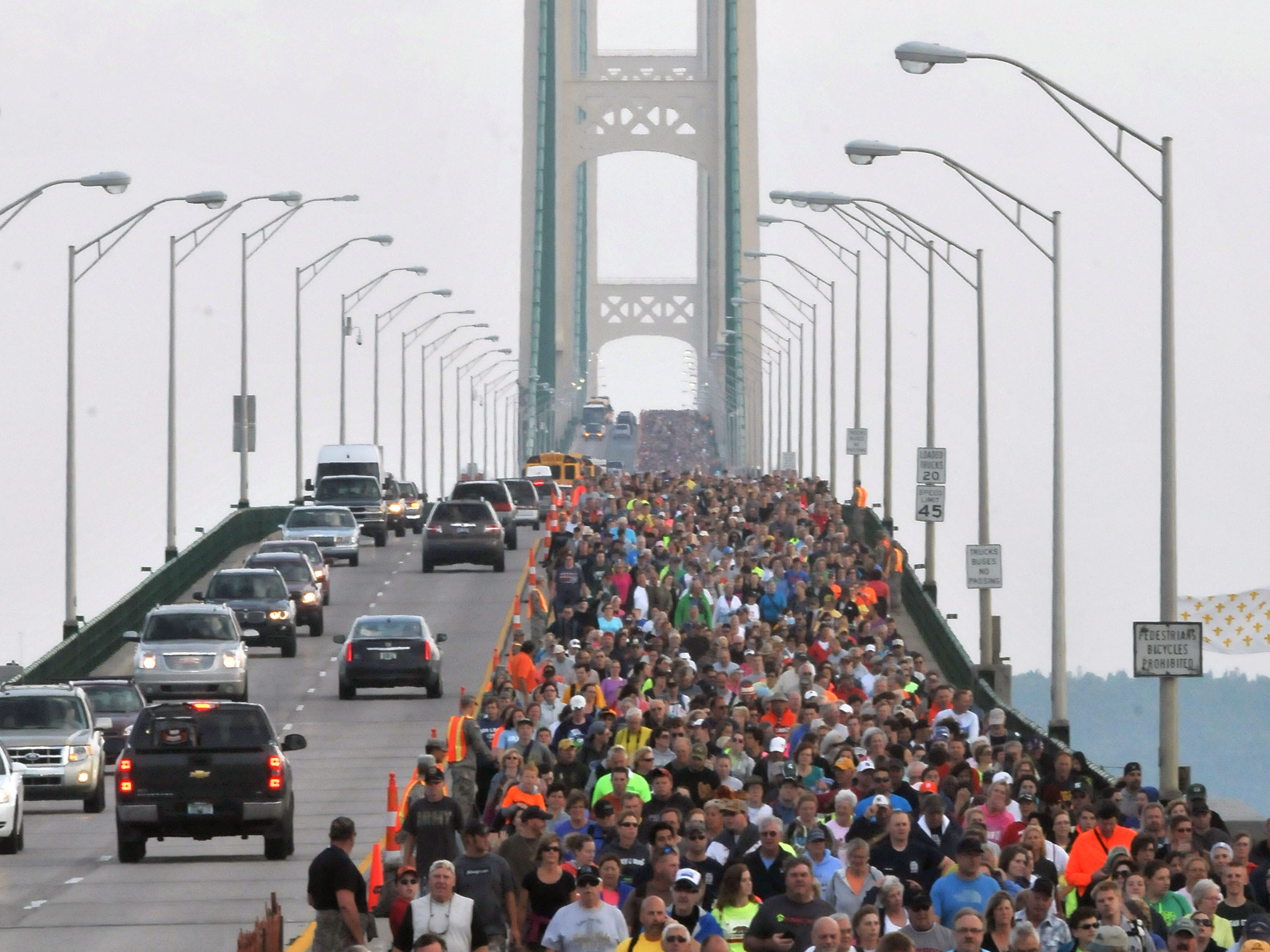 Walkers cross the five-mile-long Mackinac Bridge Monday, Sept. 1, 2014 celebrating Labor Day during the 57th annual Labor Day walk. Lead by Michigan Gov. Rick Snyder, thousands cross from the upper peninsula of Michigan to the lower peninsula, the only day pedestrians are allowed on the span.