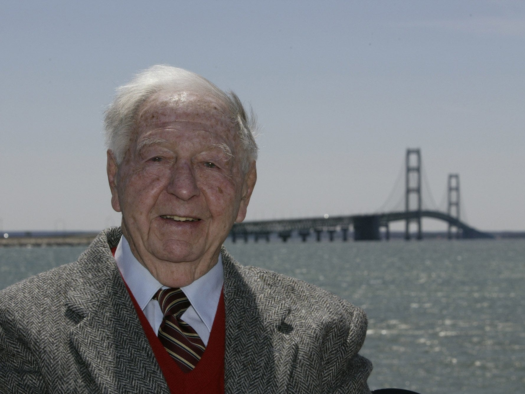 Lawrence Rubin, the first executive secretary of the Mackinac Bridge Authority, stands in front of the bridge on Friday, May 7, 2004. Even as dignitaries broke ground May 7, 1954, skeptics considered the project farfetched: a bridge across the 5-mile-long, windswept waters separating Michigan's Lower and Upper Peninsulas.